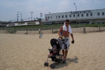Charlie DeRose 19 - (the missing in action from Easter dinner son)  taking his nephew for a stroll on the boardwalk to a